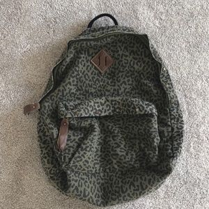Leopard backpack with stud detailing